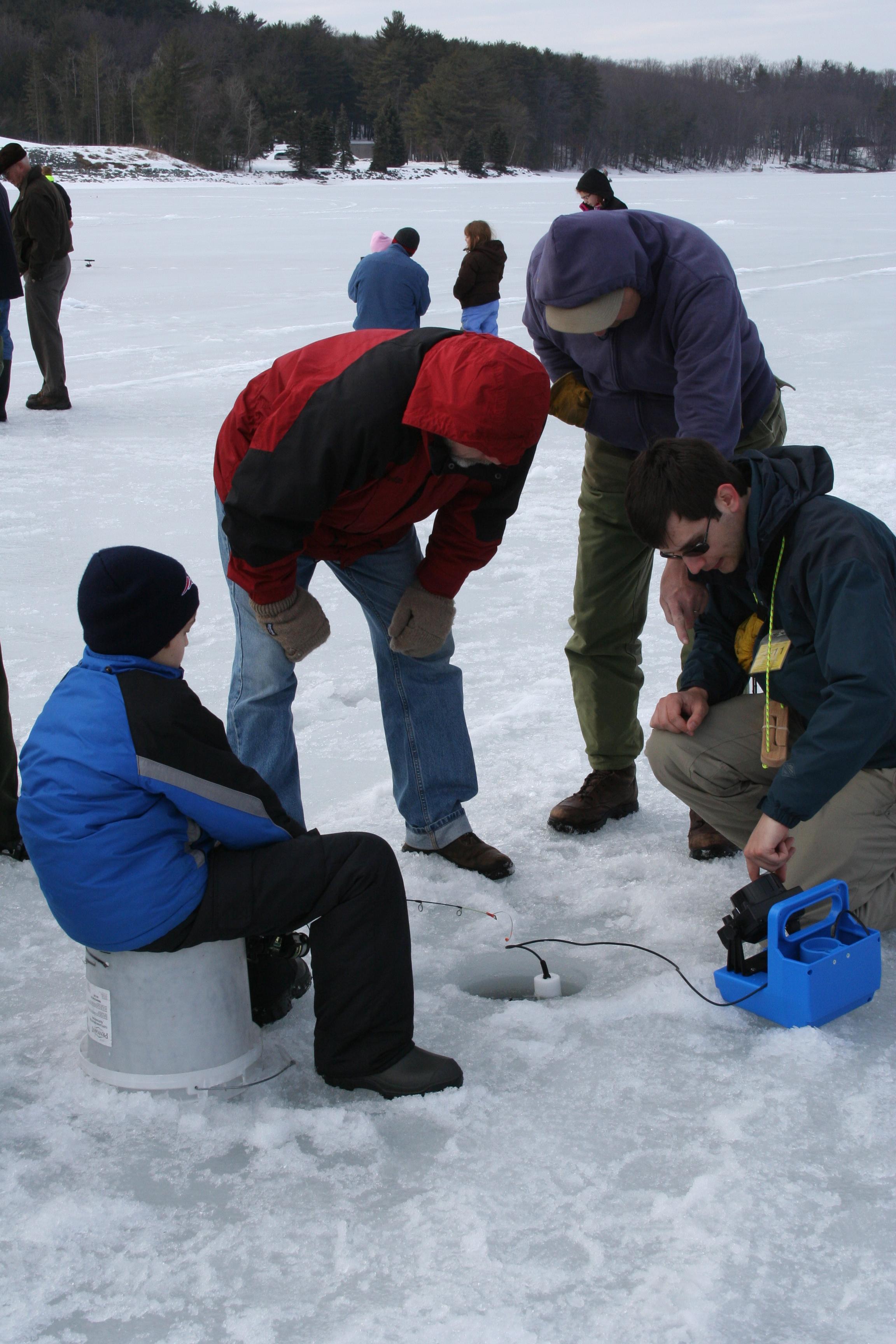 Over 50 people enjoy afternoon ice fishing on lake for Lake wallenpaupack fishing